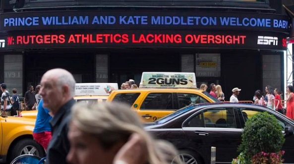 A news ticker in Times Square in New York informs the public of the birth of the royal baby to Britain's Prince William and his wife Catherine, Duchess of Cambridge